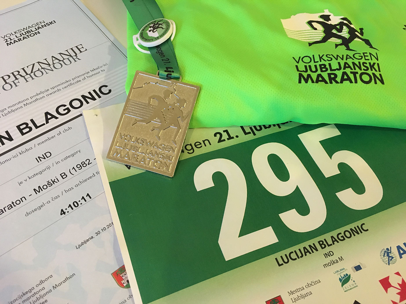 Finishers medal, number, shirt and certificate.